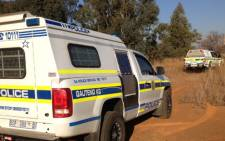 Police investigate the murder of a senior Johannesburg policeman, near Hammanskraal, just outside Pretoria, on 18 June 2013. Picture: Barry Bateman/EWN