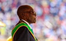 FILE: This file photo taken on 18 April 2017 shows Zimbabwe's former president, Robert Mugabe, reviewing the guard of honour during the country's 37th Independence Day celebrations at the National Sports Stadium in Harare. Picture: AFP