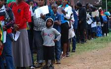 Scores of Zimbabweans wait outside the South African Home Affairs offices to apply for a permit to stay in the country. Picture: Eyewitness News.