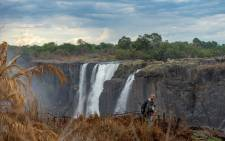FILE: A tourist views the majestic Victoria Falls, a tourism attraction for Zimbabwe, Victoria Falls, on 13 November 2019. Picture: AFP