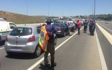 Police patrol as motorists march during an e-toll drive-slow on 8 November 2013. Picture: Sebabatso Mosamo/EWN.