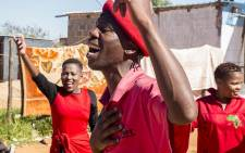 An EFF supporter raises his fist while he sings as the party made its way through the Coligny community to garner support ahead of their march on 19 May 2017. Picture: Reinart Toerien/EWN.