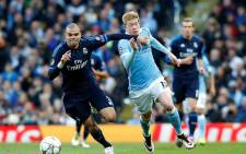 Real Madrid's defender Pepe fighting for the ball with Manchester City's Kevin de Bruyne in the first leg of the Uefa Champions League on 26 April 2016. Picture: Manchester City official Facebook page.