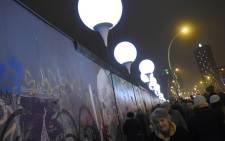 The preserved segment of the Berlin Wall called East Side Gallery, where the Light Border (Lichtgrenze), a lightened balloons installation on the route of the former border between East and West-Berlin, has been installed to mark the 25th anniversary of the fall of the Berlin Wall. Picture: AFP.