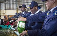Acting Western Cape Police Commissioner Major General Thembisile Patekile (L) headed the disposal of 10 000 litres of confiscated alcohol from unlicensed liquor vendors in the Western Cape. Picture: Thomas Holder/EWN.