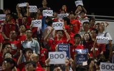 Hong Kong fans holding 'boo' placards during Chinese national anthem. Picture: @SportCorruption/Twitter.