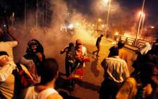 Egyptian supporters of the Muslim Brotherhood rallying in support of deposed president Mohamed Morsi clash with police outside the elite Republican Guards base in Cairo early on July 8, 2013. Picture AFP/Mahmoud Khaled.