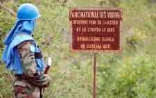 FILE: A UN peacekeeper stands near a board forbidding hunting in the Virunga National Park in the Democratic Republic of Congo. Picture: AFP.
