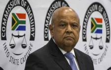 Minister of Public Enterprise Pravin Gordhan arrives to testify at the Zondo commission of inquiry into state capture on 19 November 2018. Picture: AFP