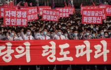 In a photo taken on 12 October 2020 participants wearing face masks attend a rally marking the start of an '80-day Campaign' in support of the upcoming 8th Congress of the Workers' Party of Korea (WPK) to be held in January 2021, at Kim Il Sung Square in Pyongyang.