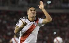 Argentina's River Plate midfielder Juan Quintero celebrates after scoring the team's second goal against Argentina's Independiente during the Copa Libertadores 2018 quarterfinals second leg football match at the Monumental stadium in Buenos Aires, Argentina, on 2 October 2018. Picture: AFP