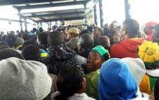 Crowds of people wait to board Rea Vaya buses following the national memorial service for Nelson Mandela at FNB Stadium on 10  December 2013. Picture: Twitter/@Juliusmekwa.