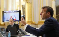 French President Emmanuel Macron speaks with Tedros Adhanom Ghebreyesus, Director General of the World Health Organization, and other world leaders about the coronavirus outbreak during a video conference at the Elysee Palace, on 24 April 2020 in Paris. Picture: AFP.