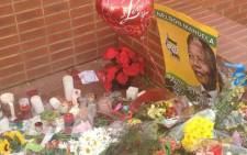 Flowers, balloons and candles left at the Mandela House in Soweto. Picture: Govan Whittles/EWN