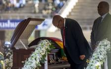 Former South African President Jacob Zuma bows to the late former President Robert Mugabe at the official funeral ceremony at the National Sports Stadium in Harare on 14 September 2019. Picture: Thomas Holder/EWN