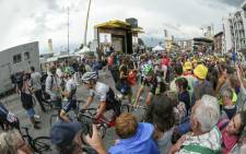 Fans swarm to the podium while cyclists having just finish try to make their way through the crowds. Picture: Thomas Holder/EWN.