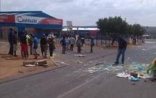 Customers' cars were damaged at KFC in Cosmo City during violent protests on 8 April 2015. Picture: Mia Lindeque/EWN