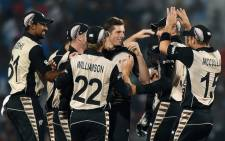 New Zealand bowler Mitchell Santner (C) celebrates with team mates after the wicket of Indias batsman Rohit Sharma during the World T20 cricket tournament match between India and New Zealand at The Vidarbha Cricket Association Stadium in Nagpur on 15 March, 2016. Picture: AFP.