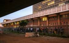 FILE: Refugees queue at the Customs House building in Cape Town. Picture: EWN.