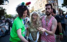 A participant of the Gay Pride parade reacts after Yishai Shlissel, an ultra-orthodox Jew, stabbed six people taking part in the march in central Jerusalem on 30 July 2015, seriously wounding two, Israeli police and health services said. Picture: AFP.