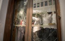 The glass doors leading to Poorthuis were extensively damaged by EFF supporters using a fire extinguisher and other missiles after the party's MPs were removed from Parliament. Picture: Aletta Harrison/EWN