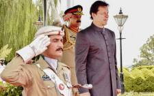 New Pakistani Prime Minister Imran Khan inspects a guard of honour on his arrival in the Prime Minister House during a ceremony in Islamabad. Khan was sworn in at a ceremony in Islamabad on 18 August. Picture: AFP