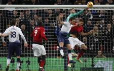 Manchester United's Spanish goalkeeper David de Gea (2R) punches the ball to make a save during the English Premier League football match between Tottenham Hotspur and Manchester United at Wembley Stadium in London, on 13 January 2019. Manchester United won 1-0. Picture: AFP