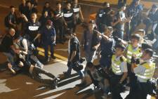 Hong Kong police disperse pro-democracy protesters from the Occupy Central movement who had previously occupied a tunnel road in Admiralty District of Hong Kong on 15 October 2014. Picture: EPA.