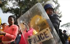 Police maintain a heavy presence outside the Bellville Magistrates Court where supporters of Andile Lili and Loyiso Nkohla gathered on Tuesday 12 August 2014. Picture: Thomas Holder/EWN.