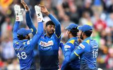 Sri Lanka team mates celebrate after beating Australia in the second Twenty20 International in South Geelong, Victoria on 19 February 2017. Picture: @OfficialSLC.