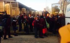FILE. Some pupils at the Roodepoort Primary School boarding buses to take them to a nearby school on 19 August, 2015. Picture: Ziyanda Ngcobo/EWN.