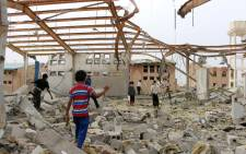 FILE: Yemenis inspect the damage caused by a Saudi-led air strike on a cholera treatment centre supported by Doctors Without Borders (MSF) in the Abs region of Yemen on 11 June 2018.