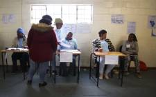 The three main stations of all voting stations, where a voter receives their ballot before voting. Picture: Bertram Malgas