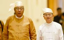 Myanmar's new President Htin Kyaw (L) and outgoing president Thein Sein (R) arrive for the handover ceremony at the presidential palace in Naypyidaw on 30 March 2016. Picture: Ye Aung Thu / Pool / AFP.