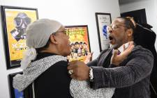 In this file photo taken on 19 January 2019 Melvin Glover, aka Melle Mel hugs Guy O'Brien, aka Master Gee from the Sugarhill gang at the Hip-Hop Museum Pop Up Experience in Washington, DC. Picture: AFP