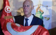 Conservative academic Kais Saied celebrates his victory in the Tunisian presidential election in the capital Tunis on 13 October 2019. Picture: AFP