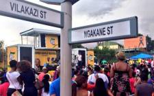 People gather on Vilakazi Street in Soweto to celebrate the life of Nelson Mandela, 14 December 2013. Picture: Lesego Ngobeni/EWN.