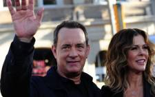 "Actor Tom Hanks arrives with his wife, actress and producer Rita Wilson, for the world premiere of ""Larry Crowne,"" June 27, 2011 at the Chinese Theatre in Hollywood, California. Picture: AFP."