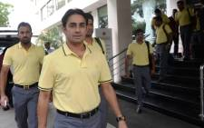 Pakistan cricketer Saeed Ajmal leaves alongside team members for Sri Lanka in Karachi on 2 August 2014. Picture: AFP.