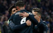 Real Madrid's Marco Asensio (left) celebrates his goal against Ajax Amsterdam in their UEFA Champions League match on 13 February 2019. Picture: @realmadriden/Twitter