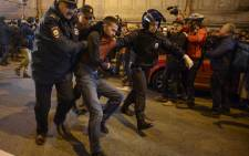 Russian police officers detain a supporter of opposition leader Alexei Navalny during an unauthorized rally in Saint Petersburg on 7 October 2017. Picture: AFP