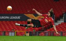 Manchester United striker Edinson Cavani hits an unsuccessful shot during the UEFA Europa League semi-final, first leg football match between Manchester United and Roma at Old Trafford stadium in Manchester, north west England, on 29 April 2021. Picture: Paul Ellis/AFP