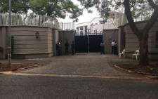 The Asset Forfeiture Unit raids the Gupta compound in Saxonwold on 16 April 2018. Picture: Pelane Pakgadi/EWN.