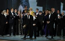 """Writer-producer D.B. Weiss (C-L) and the cast of """"Game of Thrones"""" accept the award Outstanding Drama series onstage during the 70th Emmy Awards in Los Angeles on 17 September 2018. Picture: AFP"""