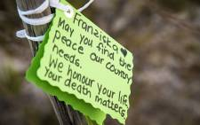 About 3,000 people attended a vigil in March 2015 for murdered teen Franziska Blchliger at Tokai Forest to pay their respects with notes and flowers. Picture: Thomas Holder/EWN.