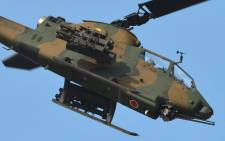 FIEL: A Japanese Ground Self Defense Force attack helicopter. Picture: AFP