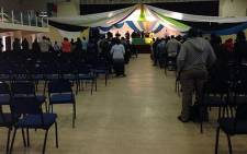 People are starting to trickle into the Nangoza Jebe Hall in New Brighton for a prayer service for Madiba. Picture: Carmel Loggenberg/EWN.