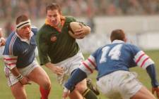FILE: Springbok winger James Small (centre) fights for the ball with French Christophe Califano (L) and Laurent Leflamand on 7 December 1996 at the Parc des Princes stadium in Paris during a Test match which South Africa won 13-12. Picture: AFP.