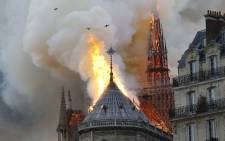 Smoke and flames rise during a fire at the landmark Notre-Dame Cathedral in central Paris on 15 April 2019. Picture: AFP