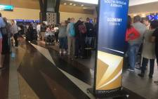 Queues at OR Tambo International Airport due to SAA strike. Picture: Mia Lindeque/EWN.
